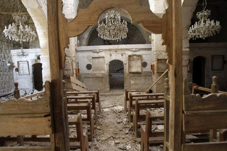 Debris lie inside a damaged church in Mar Bacchus Sarkis monastery, in Maloula village, northeast of Damascus, after soldiers loyal to Syria