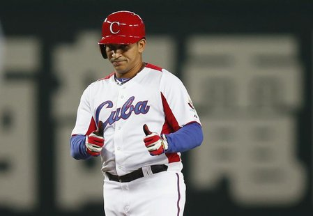 Cuba's Frederich Cepeda reacts after hitting an RBI double against Japan in the fourth inning at the World Baseball Classic (WBC) qualifying