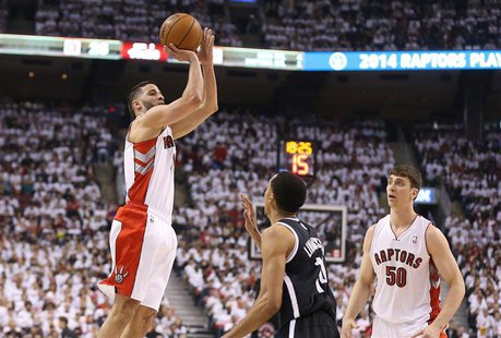 Apr 19, 2014; Toronto, Ontario, CAN; Toronto Raptors guard Greivis Vasquez (21) hits a three-pointer against the Brooklyn Nets in game one d