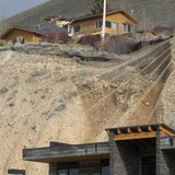 A ridge top home is split in pieces as a slow-moving landslide threatens several houses and businesses in Jackson Hole, Wyoming April 18, 20