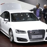 Visitors look at an Audi S8 car at Auto China 2014 in Beijing April 20, 2014. REUTERS/Jason Lee