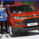 A model poses beside a Ford Ecosport during a media presentation of the 34th Bangkok International Motor Show in Bangkok March 26, 2013. REU