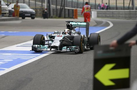 Mercedes Formula One driver Lewis Hamilton of Britain drives to a pit stop during the Chinese F1 Grand Prix at the Shanghai International Ci