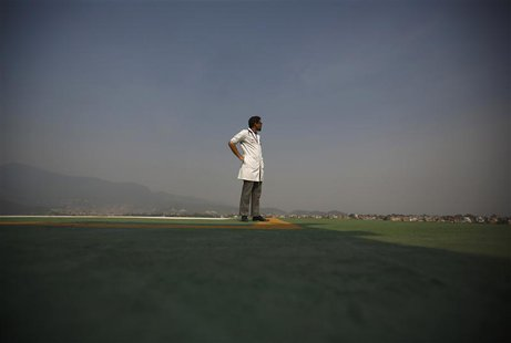 A doctor expecting the arrival of the victims of a Mount Everest avalanche standbys near the helipad at Grandi International Hospital in Kat