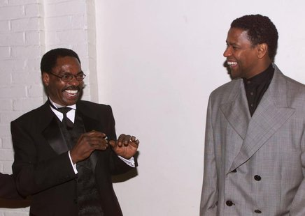 "Actor Denzel Wahington (R), star of the new film ""The Hurricane,"" based on the true story of Rubin ""Hurricane"" Carter (C), an innocent man w"
