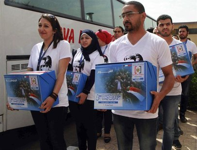 Youths working for leftist politician Hamdeen Sabahi submit boxes of endorsements collected as Sabahi arrives to submit his bid to run as pr