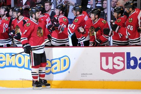Jan 12, 2014; Chicago, IL, USA; Chicago Blackhawks defenseman Brent Seabrook (7) is congratulated by his teammates for scoring a goal agains