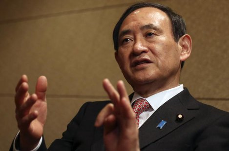 Japan's Chief Cabinet Secretary Yoshihide Suga speaks during an interview with Reuters in Tokyo February 15, 2014. To match interview JAPAN-