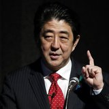 Japan's Prime Minister Shinzo Abe gestures as he gives a keynote address at Japan Summit 2014 hosted by the Economist magazine in Tokyo Apri