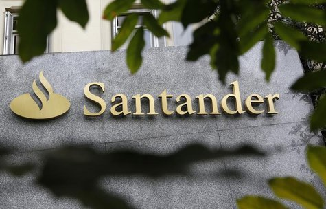 The logo of Spanish bank Santander is seen outside a building in Madrid October 27, 2011.REUTERS/Andrea Comas