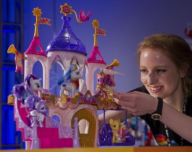 "Toy demonstrator Christa Sparks shows off the new ""My Little Pony Pony Princess Wedding Castle"" playset, part of a new line of wedding-theme"