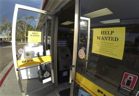 A help wanted sign is posted on the door of a gas station in Encinitas, California September 6, 2013. REUTERS/Mike Blake