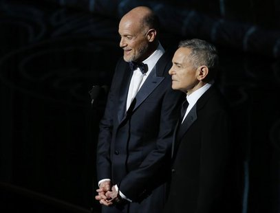 Craig Zadan and Neil Meron, Academy Award Producers, look on at the 86th Academy Awards in Hollywood, California March 2, 2014. REUTERS/Lucy