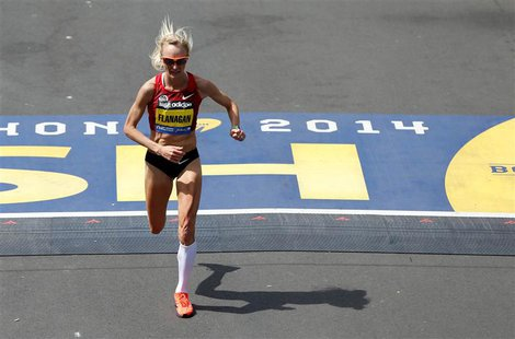 Apr 21, 2014; Boston, MA, USA; Shalane Flanagan (USA) crosses the finish line during the 2014 Boston Marathon. Mandatory Credit: Greg M. Coo