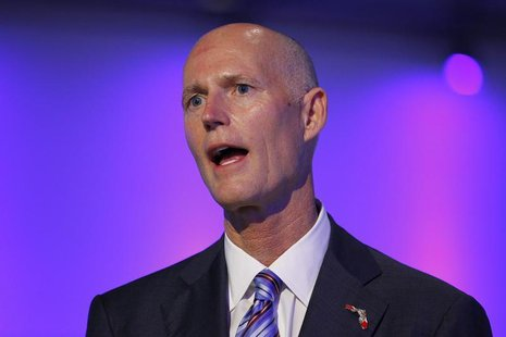 Florida Republican Gov. Rick Scott speaks at a ceremony opening new newsroom facilities for the Univision and Fusion television networks in
