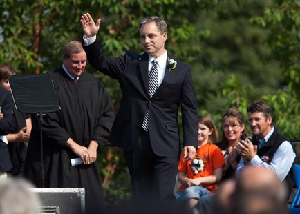 Alaska Governor Sean Parnell waves to crowd after being sworn in at the annual Governor's Picnic in Fairbanks, Alaska, July 26, 2009. REUTER