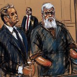 Islamist cleric Abu Hamza al-Masri is seen in this courtroom sketch standing with his lawyer Jeremy Schneider where he pleaded not guilty to