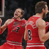 Chicago Bulls center Joakim Noah (13) and Chicago Bulls guard Marco Belinelli celebrate after they beat the Brooklyn Nets to advance to the