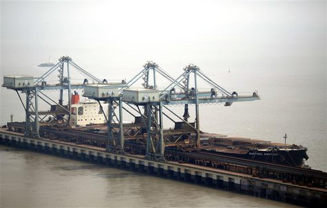 The Baosteel Emotion, a 226,434 deadweight-tonne ore carrier owned by Mitsui O.S.K. Lines, is docked at the port of Maji Island, south of Sh