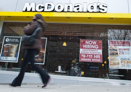 A passersby walks in front of a help wanted sign at a McDonalds restaurant in the Brooklyn borough of New York, March 7, 2014. REUTERS/Keith