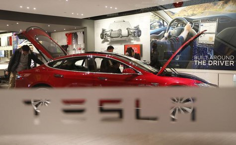 A man looks around Tesla Motors' Model S P85 at its showroom in Beijing January 29, 2014. REUTERS/Kim Kyung-Hoon