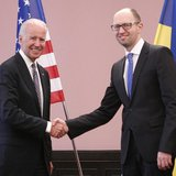 U.S. Vice President Joe Biden (L) shakes hands with Ukraine's Prime Minister Arseny Yatseniuk during a meeting in Kiev, April 22, 2014. REUT