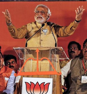 Hindu nationalist Narendra Modi, prime ministerial candidate for the main opposition Bharatiya Janata Party (BJP), gestures as he addresses