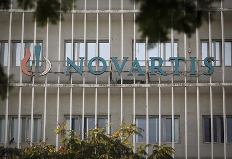 A Novartis logo is pictured on its headquarters building in Mumbai February 6, 2014. REUTERS/Danish Siddiqui