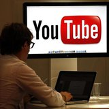 The YouTube logo is seen on a screen in a file photo. REUTERS/Eric Gaillard