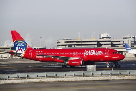 A JetBlue Airbus A320-200 plane with a New York Fire Department logo painted on its side stands on the tarmac of the John F. Kennedy Interna