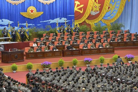 North Korean leader Kim Jong Un (front row on stage, 5th L) speaks while presiding over the first meeting of the airpersons of the Korean Pe
