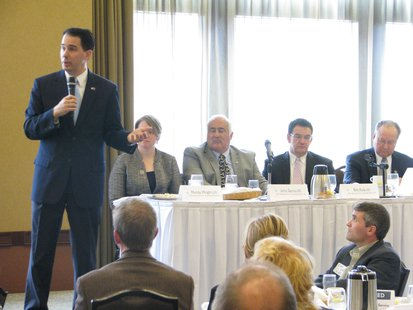 Governor Scott Walker addresses Wausau Chamber of Commerce.  Seated at the table Left to Right: State Representatives Mandy Wright, John Spiros, Bob Kulp, and Senator Jerry Petrowski