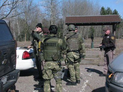 SWAT team officers at staging area near Wittenberg hostage incident 4/22/14  Photo: WSAU