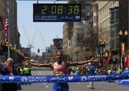 Meb Keflezighi of the U.S. reacts as he comes to the finish line at the 118th running of the Boston Marathon in Boston, Massachusetts April 21, 2014. CREDIT: REUTERS/BRIAN SNYDER