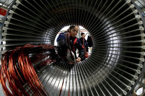 A worker assembles a generator at a factory in Hefei, Anhui province November 2, 2013. REUTERS/China Daily