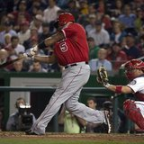 Apr 22, 2014; Washington, DC, USA; Los Angeles Angels first baseman Albert Pujols (5) hits a two-run home run during the fifth inning agains
