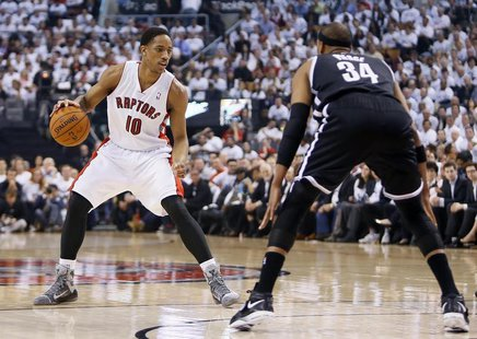 Apr 22, 2014; Toronto, Ontario, CAN; Toronto Raptors guard DeMar DeRozan (10) controls the ball against Brooklyn Nets forward Paul Pierce (3