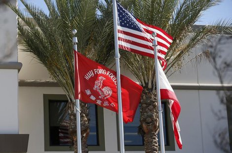 Flags flutter outside the Huy Fong Foods factory, maker of Sriracha hot chili sauce, in Irwindale, California October 30, 2013. REUTERS/Lucy