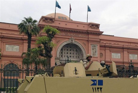 A soldier in a military vehicle keeps guard in front of the Egyptian Museum in Tahrir square in Cairo April 19, 2014. Picture taken April 19