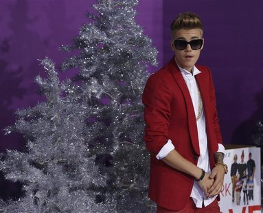 "Singer Justin Bieber poses at the premiere of the documentary ""Justin Bieber's Believe"" in Los Angeles, California December 18, 2013. REUTER"