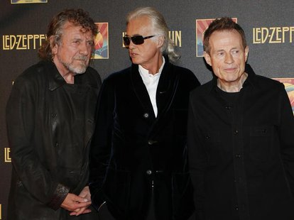 Led Zeppelin singer Robert Plant (L), guitarist Jimmy Page (C) and bassist/keyboardist John Paul Jones pose for photographers as they arrive