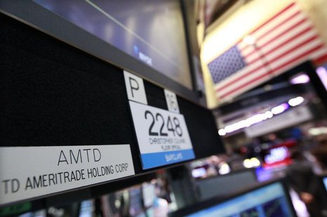 A sign with the ticker symbol for TD Ameritrade is seen at the trading post that trades the company on the floor of the New York Stock Excha