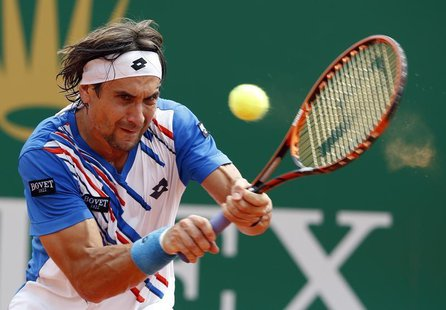 David Ferrer of Spain returns the ball to his compatriot Rafael Nadal during their quarter-final match at the Monte Carlo Masters in Monaco
