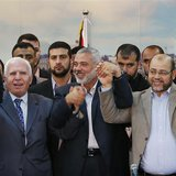 Senior Fatah official Azzam Al-Ahmed (L), head of the Hamas government Ismail Haniyeh (C) and senior Hamas leader Moussa Abu Marzouq hold th