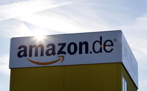 The sun reflects off Amazon's logistics centre in Graben near Augsburg December 16, 2013. REUTERS/Michaela Rehle