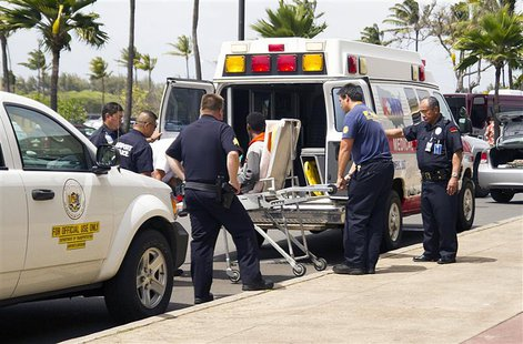 A 16-year-old boy is carried on a stretcher in Maui, Hawaii, April 20, 2014, as seen in this handout photo courtesy of Chris Sugidono,The Ma