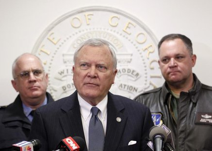 Georgia Governor Nathan Deal (C), speaks to the media as Public Safety Director Mark McDonough (L), and Georgia National Guard Director Gene