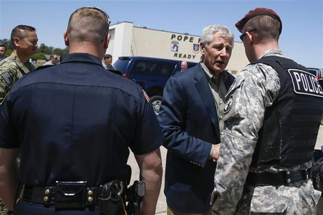 U.S. Defense Secretary Chuck Hagel (2nd R) hands out commander coins before leaving Pope Army Airfield in Fort Bragg, North Carolina April 2