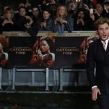 "Actor Sam Claflin reacts as he arrives for the world premiere of ""The Hunger Games : Catching Fire"" at Leicester Square in London November 1"