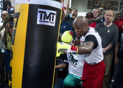 World Boxing Council (WBC) welterweight champion Floyd Mayweather Jr. of the U.S. hits a punching bag during a media workout at the Mayweath